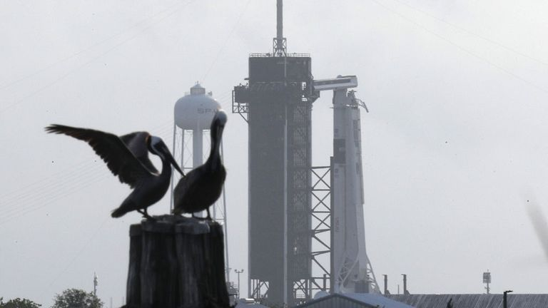 CAPE CANAVERAL, FLORIDA - MAY 26: The SpaceX Falcon 9 rocket with the Crew Dragon spacecraft attached is seen as it is prepared for tomorrow's scheduled liftoff from launch pad 39A at the Kennedy Space Center on May 25, 2020 in Cape Canaveral, Florida. NASA astronauts Bob Behnken and Doug Hurley will be aboard the inaugural flight and will be the first people since the end of the Space Shuttle program in 2011 to be launched into space from the United States. (Photo by Joe Raedle/Getty Images)