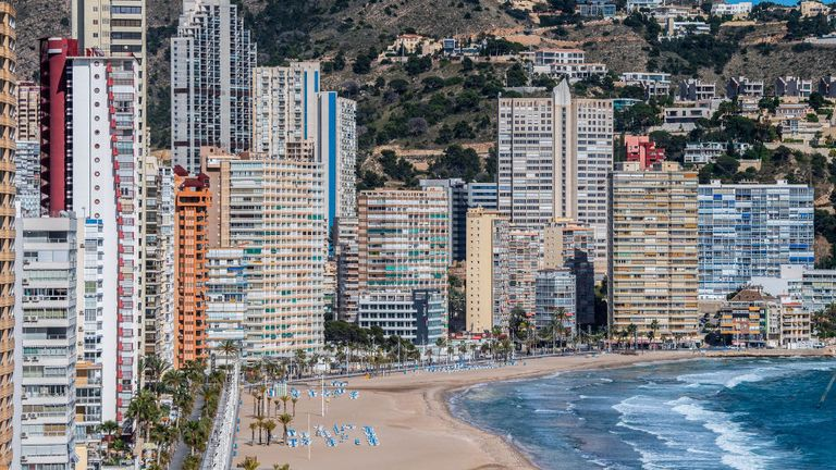 "BENIDORM, SPAIN - MAY 11: Apartment towers sit along the promenade of the closed Playa de Levante Beach on May 11, 2020 in Benidorm, Spain. Some parts of Spain have entered the so-called ""Phase One"" transition from its coronavirus lockdown, allowing many shops to reopen as well as restaurants who serve customers outdoors. Locations that were harder hit by coronavirus (Covid-19), such as Madrid and Barcelona, remain in a stricter ""Phase 0"" quarantine. (Photo by David Ramos/Getty Images)"