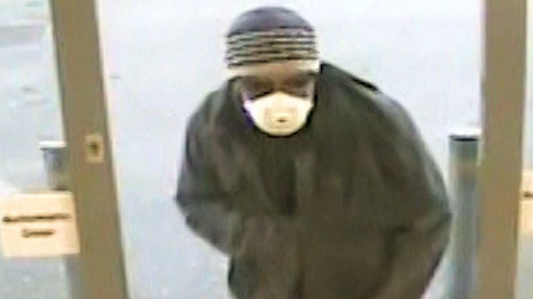 The suspect wore a beanie hat and white surgical facemask