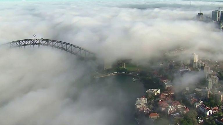 Sydney Harbour Bridge is engulfed by fog