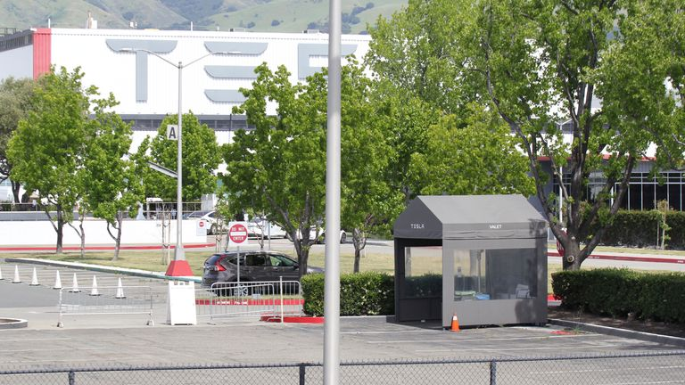 A valet parking tent is seen empty in the parking lot of Tesla