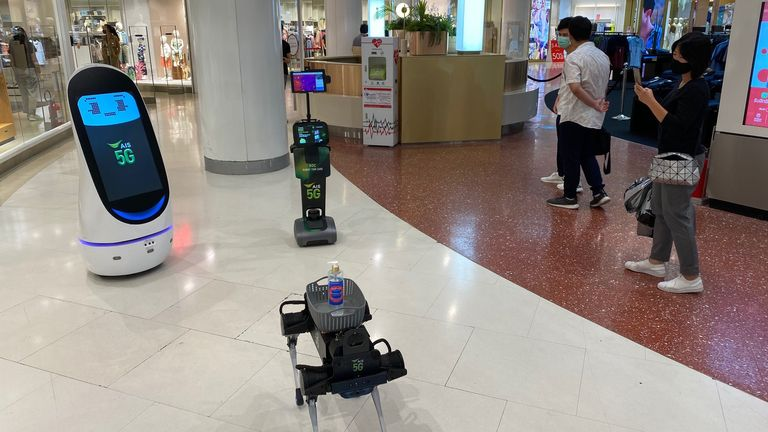 A team of robots are trying to keep shoppers safe from coronavirus