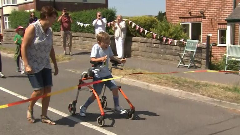 Tobias Weller - who has cerebral palsy - has completed the final leg of his marathon, raising over £4ok for the NHS and his local school