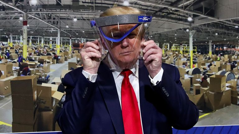 Donald Trump did pose with a transparent visor, but did not wear a mask
