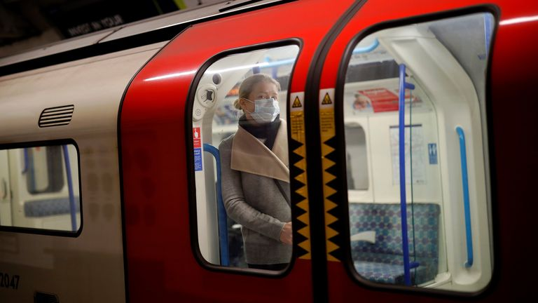 A commuter wearing a face mask on the London Underground on Monday morning