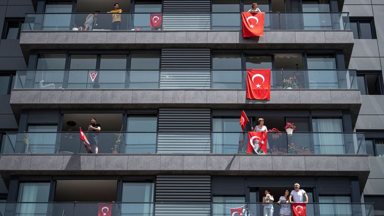 Turks celebrate Youth and Sports Day by displaying their country's flag out of windows