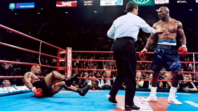 November 1996: Holyfield floors Tyson in their first bout. He won by technical knockout in the 11th round