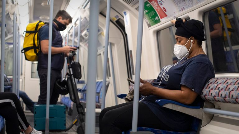 Commuters wearing face masks on the Jubilee line in central London