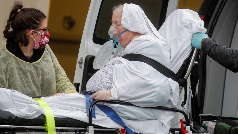 Paramedics unload a patient at a hospital in Brooklyn