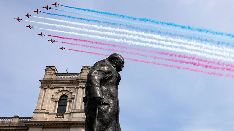 The Red Arrows fly over the statue of Winston Churchill in London