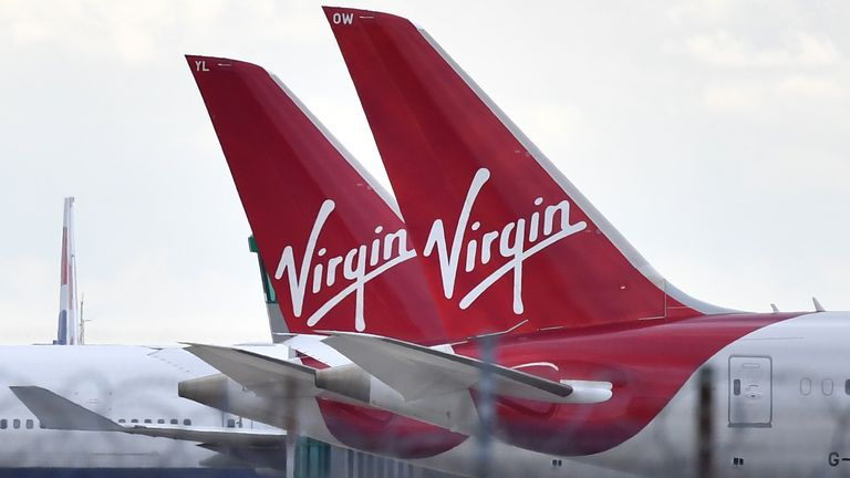 Tailfins of parked Virgin Atlantic passenger aircraft are pictured on the apron at Heathrow Airport