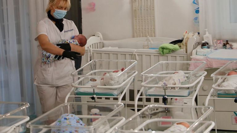 A nurse and newborns are seen in the Hotel Venice owned by BioTexCom clinic in Kiev, Ukraine May 14, 2020. At least fifty babies born to surrogate mothers are stranded in a Ukrainian clinic as the coronavirus disease (COVID-19) lockdown prevents their foreign parents from collecting them. Picture taken May 14, 2020