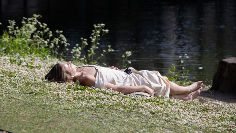 LONDON, ENGLAND - MAY 09: A member of the public sunbathes by a bridge on a warm, sunny afternoon in Regent's Park on May 09, 2020 in London, United Kingdom. The country continued quarantine measures intended to curb the spread of Covid-19, but the infection rate is falling, and government officials are discussing the terms under which it would ease the lockdown. (Photo by Jo Hale/Getty Images)