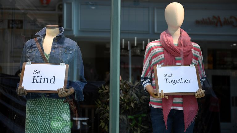 Staff from the closed White Stuff fashion store leaves messages for passersby on March 24, 2020 in Bournemouth, United Kingdom