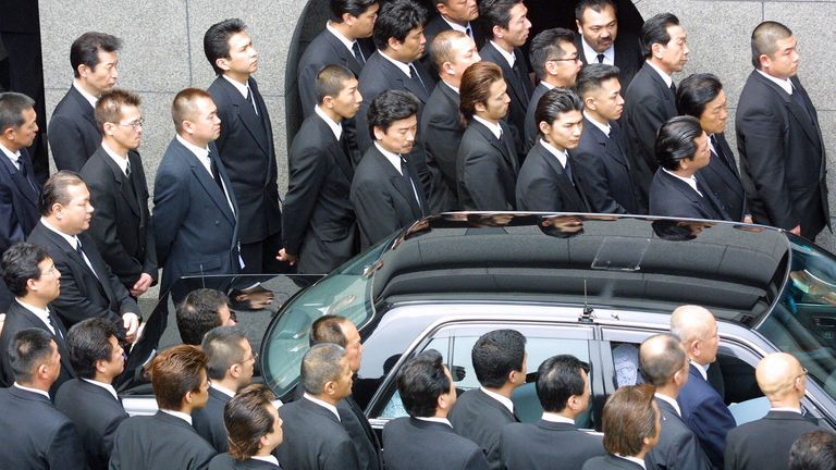 Yamaguchi-gumi members are seen gathering for the funeral of their boss in Kobe, western Japan, in 2002
