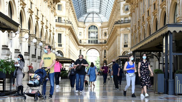 FILE PHOTO: People walk at at Galleria Vittorio Emanuele II, as Italy eases some of the lockdown measures put in place during the coronavirus disease (COVID-19) outbreak, in Milan, Italy May 18, 2020. REUTERS/Flavio Lo Scalzo/File Photo