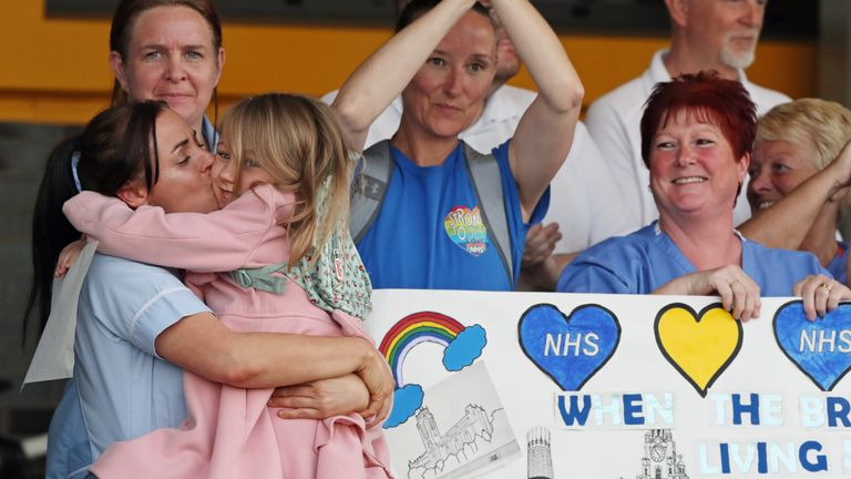 Supporters and NHS staff from Aintree University Hospital in Liverpool join in the applause to salute local heroes during Thursday's nationwide Clap for Carers to recognise and support NHS workers and carers fighting the coronavirus pandemic.