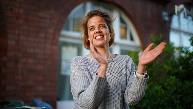 Annemarie Plas, 36, a Dutch national living in south London who created the weekly 8pm Clap For Our Carers, stands with other residents in south London, as she joins the applause to salute local heroes during Thursday's nationwide Clap for Carers to recognise and support NHS workers and carers fighting the coronavirus pandemic.