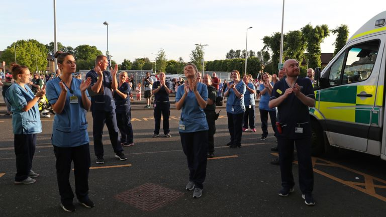 "Staff from Queen Elizabeth University Hospital in Glasgow gather as they join in the applause to salute local heroes during Thursday's nationwide Clap for Carers to recognise and support NHS workers and carers fighting the coronavirus pandemic. PA Photo. Picture date: Thursday May 28, 2020. The 10th weekly Clap for Carers event may be the last, after the woman behind the idea said she will no longer take part. Annemarie Plas, 36, a Dutch national living in south London who created the weekly 8pm Clap For Our Carers, said she has no problem with people continuing to gather at 8pm each week to clap, but said she will not be among those taking part in future. She said: ""To have the most impact I think it is good to stop it at its peak. See PA story HEALTH Coronavirus. Photo credit should read: Andrew Milligan/PA Wire"
