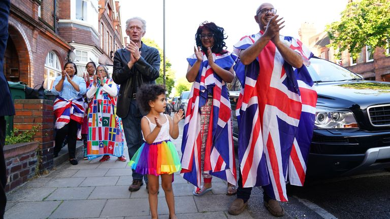 Neighbours of Annemarie Plas, 36, a Dutch national living in south London who created the weekly 8pm Clap For Our Carers, in south London joining the applause to salute local heroes during Thursday's nationwide Clap for Carers to recognise and support NHS workers and carers fighting the coronavirus pandemic.