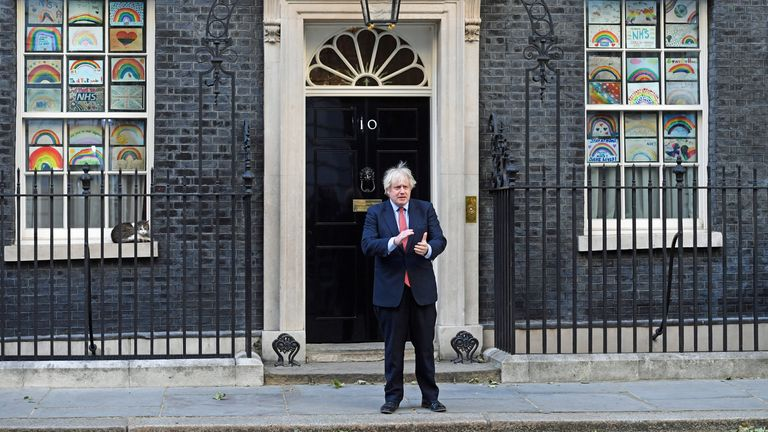 Prime Minister Boris Johnson joins in the weekly Clap for Carers outside his official London residence in Downing Street.