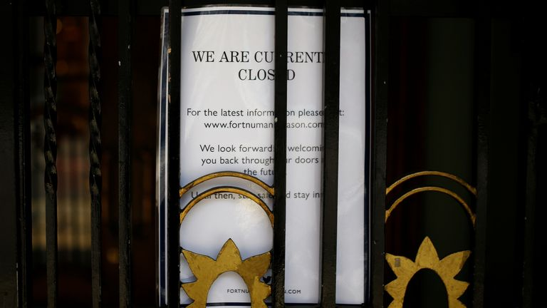 A notice is seen on a door at Fortnum & Mason, the department store in London's Piccadilly, pictured after it was reported to be furloughing 700 employees while the spread of the coronavirus disease (COVID-19) continues, in London, Britain April 9, 2020. REUTERS/Henry Nicholls