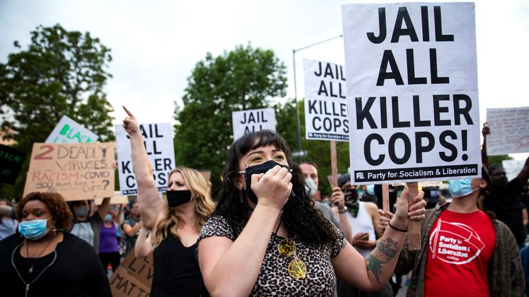 Protesters hold signs during a protest against the fatal injury inflicted by Minneapolis police on African-American man George Floyd, in Denver, Colorado, U.S. May 28, 2020. Picture taken May 28, 2020. REUTERS/Alyson McClaran