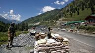 Indian soldiers stand guard at a checkpoint along a road leading to Ladakh at Gagangeer in Kashmir's Ganderbal district. Pic: Reuters/Danish Ismail