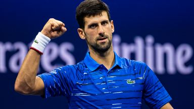 Djokovic eases to opening day double