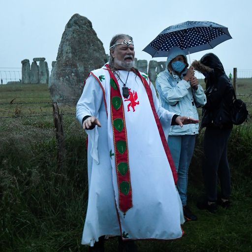 People defy Stonehenge travel ban to celebrate soggy summer solstice