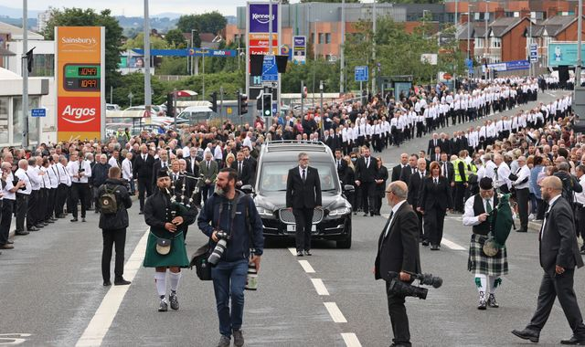 Coronavirus: Sinn Fein criticised after large crowd gathers for IRA member's funeral
