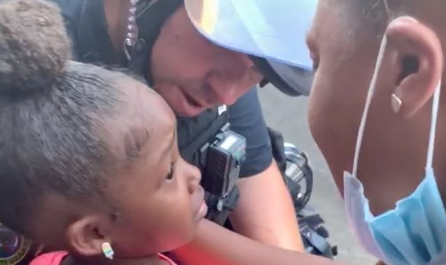 George Floyd death: Policeman hugs crying black girl who asked 'are you gonna shoot us?' during protests