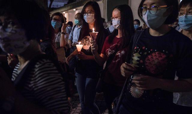 Hong Kong: Thousands defy vigil ban and light candles to mark Tiananmen anniversary