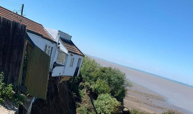 Kent: House falls over cliff edge after part of coastline collapses