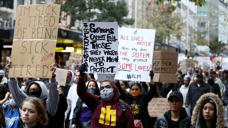 AUCKLAND, NEW ZEALAND - JUNE 01: Protestors march down Queen Street on June 01, 2020 in Auckland, New Zealand. The rally was organised in solidarity with protests across the United States following the killing of an unarmed black man George Floyd at the hands of a police officer in Minneapolis, Minnesota.  (Photo by Hannah Peters/Getty Images)