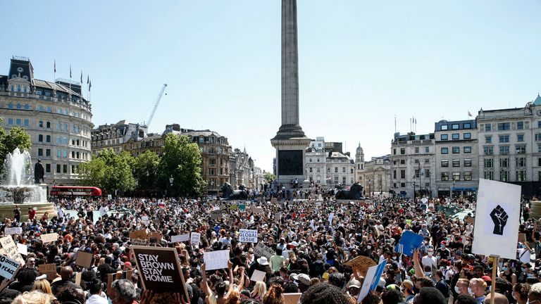 "LONDON, ENGLAND - MAY 31: People hold placards as they join a spontaneous Black Lives Matter march at Trafalgar Square to protest the death of George Floyd in Minneapolis and in support of the demonstrations in North America on May 31, 2020 in London, England. The death of an African-American man, George Floyd, at the hands of police in Minneapolis has sparked violent protests across the USA. A video of the incident, taken by a bystander and posted on social media, showed Floyd's neck being pinned to the ground by police officer, Derek Chauvin, as he repeatedly said ""I can't breathe"". Chauvin was fired along with three other officers and has been charged with third-degree murder and manslaughter. (Photo by Hollie Adams/Getty Images)"