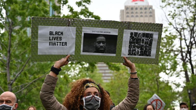 A woman is holding a Black Lives Matter placard asking for Justice for George and other victims of racism and police brutalities on Montreal's Place du Canada on May 31, 2020. - Several thousands demonstrators marched on Sunday in central Montreal against racism and police violence, in solidarity with demonstrations in the United States following the death of George Floyd. (Photo by Eric THOMAS / AFP) (Photo by ERIC THOMAS/AFP via Getty Images)