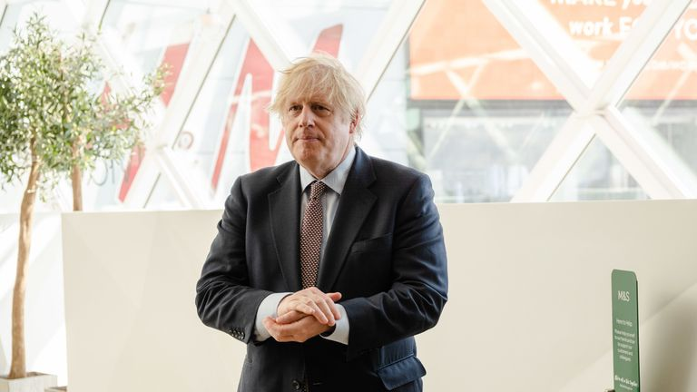 Prime Minister Boris Johnson in the M&S clothing department during a visit to Westfield Stratford in east London see the Coronavirus measures in place before reopening tomorrow.