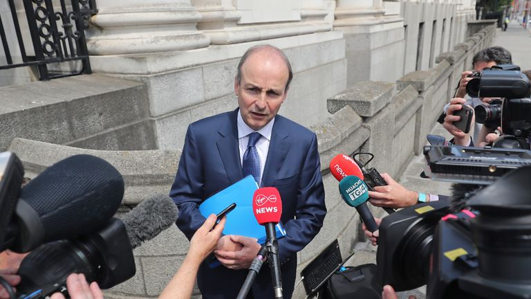 Fianna Fail leader Micheal Martin who is set to become Ireland's next premier, outside Government Buildings in Dublin, after Fianna Fail, Fine Gael and the Greens finalised the text of a draft programme for government four months on from the election.