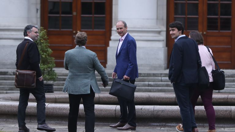 Fianna Fail leader Micheal Martin (centre) arrives at Government Buildings in Dublin to discuss outstanding issues, as leaders of Fine Gael, Fianna Fail and the Green Party are set to formally agree a draft programme for government between their parties later.