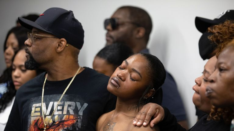 ATLANTA, GA - JUNE 15: One of Rayshard Brooks family members closes her eyes during a press conference addressing Brooks killing on June 15, 2020 in Atlanta, Georgia.Ruled a homicide, Rayshard Brooks died while fleeing from two white police officers outside an Atlanta Wendy's restaurant on June 12. (Photo by Dustin Chambers/Getty Images)