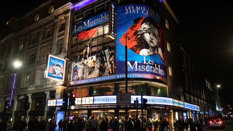 "People queuing to watch Les Miserables in London's Theatreland on the day after the Prime Minister said that Covid-19 ""is the worst public health crisis for a generation"", and the government's top scientist warned that up to 10,000 people in the UK are already infected."
