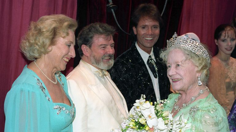 The Queen Mother backstage at the London Palladium with some of the artists who performed for her 90th birthday gala. (L-R) Dame Vera Lynn, flautist James Calway and pop star Cliff Richard.
