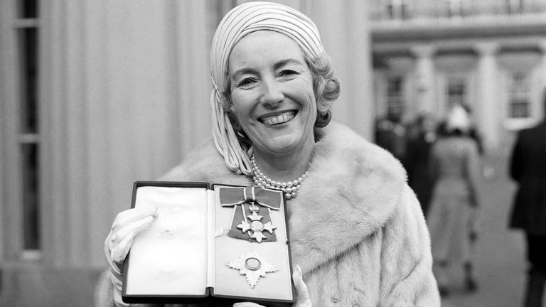Singer Vera Lynn outside Buckingham Palace after being invested a Dame Commander of the British Empire.