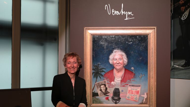 Virginia Lewis-Jones stands next to a painting by Norwegian artist Ross Kolby of her mother, 'Force's Sweetheart' Dame Vera Lynn, which was unveiled at the Royal Albert Hall in London.