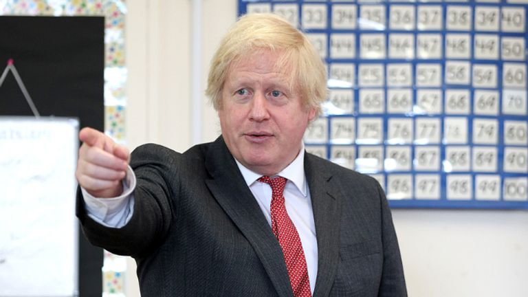 Prime Minister Boris Johnson joins a socially distanced lesson during a visit to Bovingdon Primary School in Bovingdon, Hemel Hempstead, Hertfordshire, following the announcement of a GBP 1 billion plan to help pupils catch up with their education before September after spending months out of school during the coronavirus lockdown.