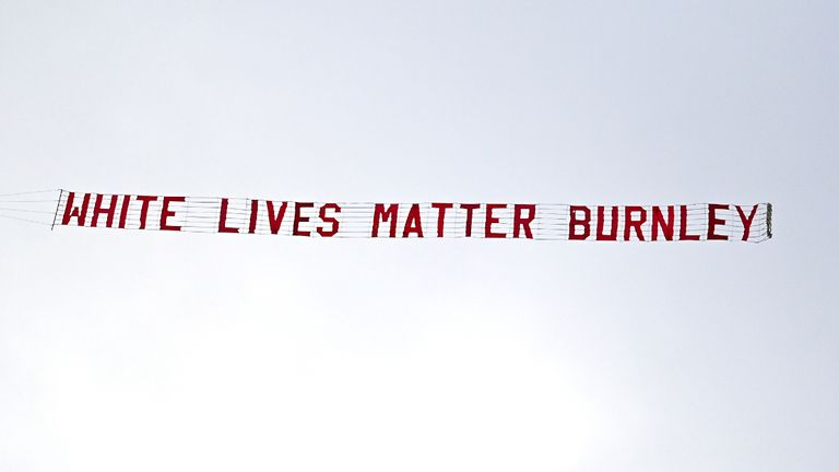 A plane flies over the stadium with a banner reading 'White Lives Matter Burnley' during the Premier League match at the Etihad Stadium, Manchester.