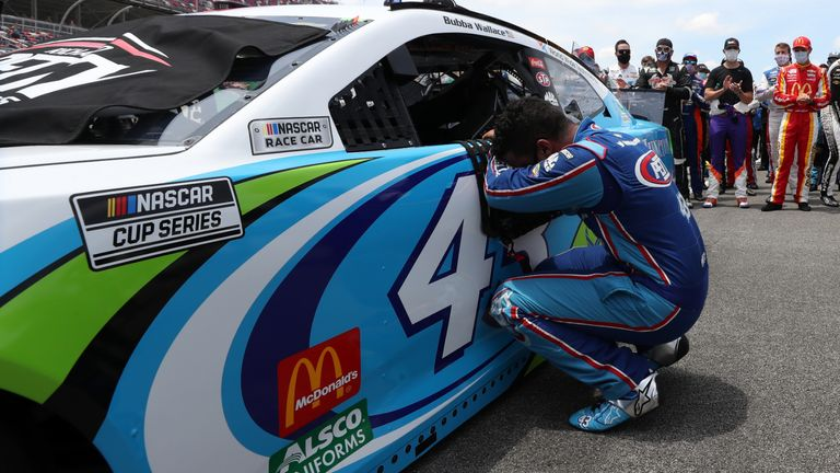 TALLADEGA, ALABAMA - JUNE 22: Bubba Wallace, driver of the #43 Victory Junction Chevrolet, takes a moment by his car after NASCAR drivers pushed him to the front of the grid as a sign of solidarity with the driver prior to the NASCAR Cup Series GEICO 500 at Talladega Superspeedway on June 22, 2020 in Talladega, Alabama. A noose was found in the garage stall of NASCAR driver Bubba Wallace at Talladega Superspeedway a week after the organization banned the Confederate flag at its facilities. (Photo by Chris Graythen/Getty Images)