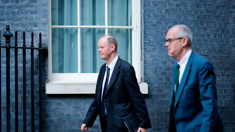 Chief Medical Officer Chris Whitty (L) and Britain's Chief Scientific Adviser Patrick Vallance (R) arrive at 10 Downing street in central London on April 9, 2020 to take part in the daily government coronavirus briefing. - British Prime Minister Boris Johnson on Thursday began a fourth day in intensive care