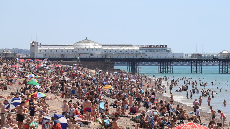 People enjoy the warm weather on Brighton beach as Thursday could be the UK's hottest day of the year with scorching temperatures forecast to rise even further.